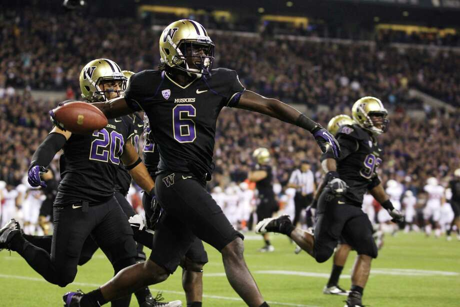 Washington's Desmond Trufant celebrates his interception against Stanford play late in the second half. Photo: Ap