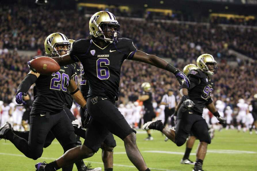 Washington's Desmond Trufant celebrates his interception against Stanford play late in the second ha