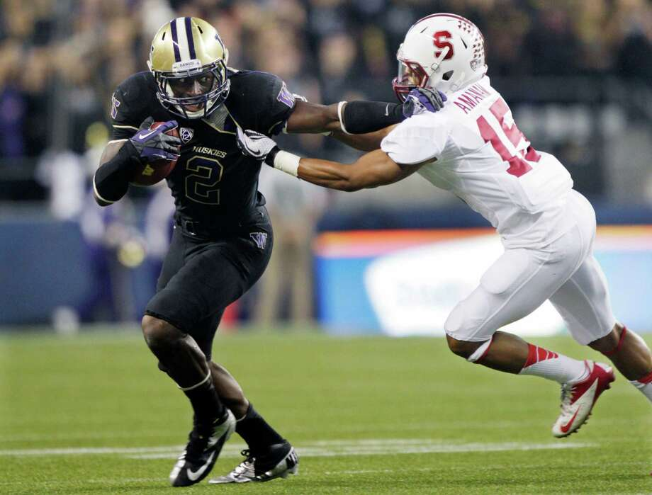 Washington's Kasen Williams tries to fend off  Stanford's Usua Amanam, right, during the first half  (AP Photo/Ted S. Warren) Photo: Associated Press