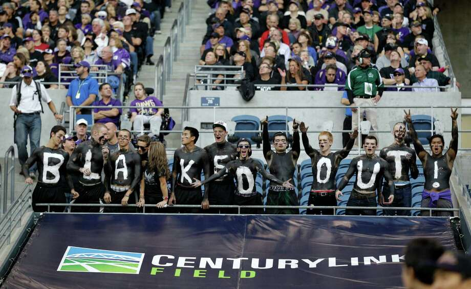 "Fans spell out ""Blacked Out!"" in honor of Washington fans and players all wearing black. (AP Photo/Ted S. Warren) Photo: Associated Press"