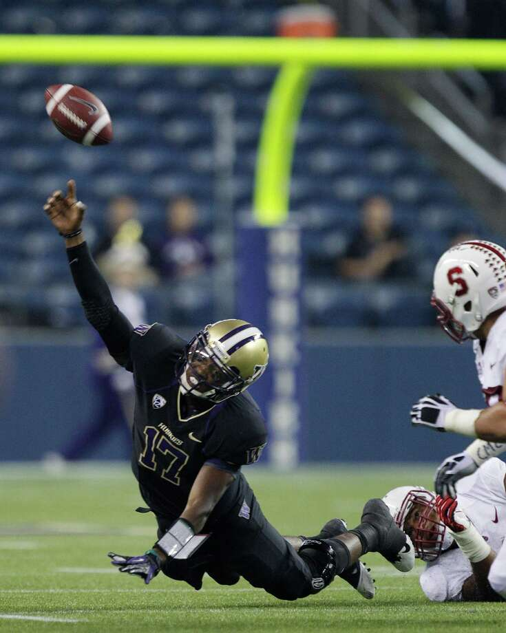 Washington quarterback Keith Price gets rid of the ball as he goes down in the first half.  Price was flagged for intentional grounding. (AP Photo/Ted S. Warren) Photo: Associated Press
