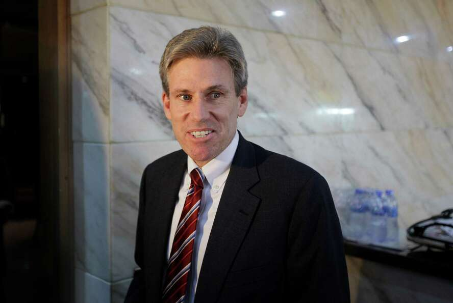 In this photo taken Monday, April 11, 2011, then U.S. envoy Chris Stevens takes a coffee before atte