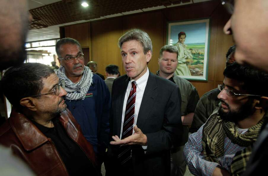 In this photo taken Monday, April 11, 2011, then U.S. envoy Chris Stevens speaks to local media befo