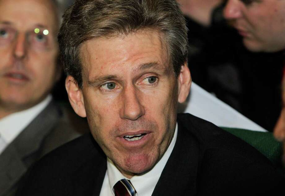 In this photo taken Monday, April 11, 2011, then U.S. envoy Chris Stevens attends meetings at the Tibesty Hotel where an African Union delegation was meeting with opposition leaders in Benghazi, Libya. Libyan officials say the U.S. ambassador and three other Americans have been killed in an attack on the U.S. consulate in the eastern city of Benghazi by protesters angry over a film that ridiculed Islam's Prophet Muhammad. (AP Photo/Ben Curtis) Photo: Ben Curtis, Associated Press / AP