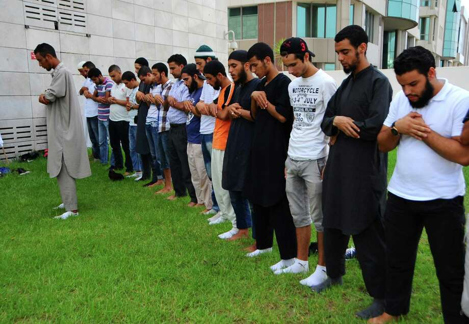 Muslims pray outside the United States embassy in Tunis, Wednesday, Sept.12, 2012 and demand the closure of the embassy. The American embassies in Algeria and Tunisia warned of more protests Wednesday, following attacks by protesters in neighboring Libya in which the U.S. ambassador and three embassy staff were killed. Photo: Hassene Dridi, Associated Press / AP