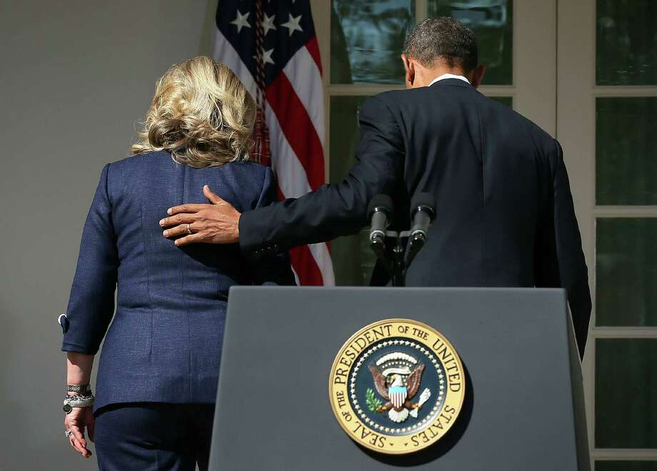 U.S. President Barack Obama (R) and Secretary of State Hillary Clinton (L) leave after a statement in response to the attack at the U.S. Consulate in Libya September 12, 2012 at the Rose Garden of the White House in Washington, DC. U.S. Ambassador J. Christopher Stevens and three other Americans were killed in an attack on the U.S. Consulate in Benghazi, Libya by protesters who were potentially angry over a controversial Prophet Muhammad video. Photo: Alex Wong, Getty Images / 2012 Getty Images