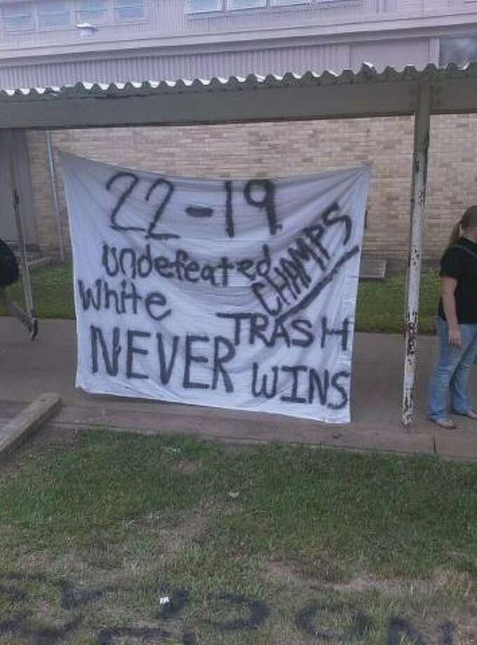 Nederland ISD and Vidor PD are investigating graffiti of racial slurs left outside of the Vidor High School gym. The vandalism is believed to have happened overnight and found Friday morning. Photo: Courtesy Of Facebook