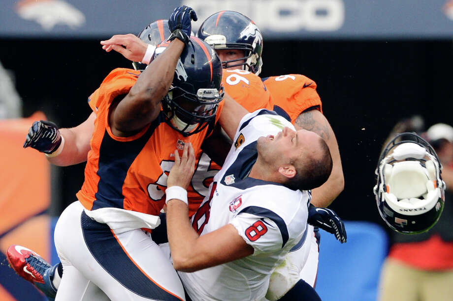 Who lost his head: Matt Schaub, Texans. Who did the headhunting: Joe Mays, Denver Broncos. Photo: Joe Amon, Associated Press / The Denver Post