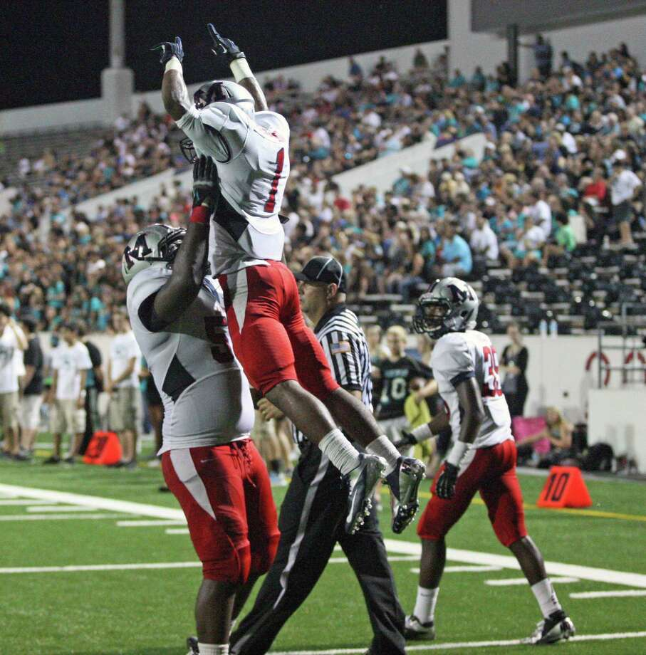 Manvel 35, Pasadena Memorial 14Manvel wide receiver Carlos Thompson (1) celebrates his 12-yard touchdown reception with teammate Kaelin Cooksey during the first half of a high school football game against Pasadena Memorial, Thursday, September 27, 2012 at Veterans Memorial Stadium in Pasadena, TX. Photo: Eric Christian Smith, For The Chronicle