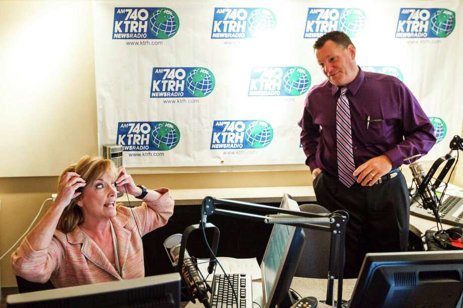 Shara Fryer, left, works her new job as a morning radio news anchor for KTRH 740-AM while talking to Matt Patrick, right, at the radio studio, Wednesday, Sept. 12, 2012, in Houston. ( Michael Paulsen / Houston Chronicle ) Photo: Michael Paulsen / © 2012 Houston Chronicle