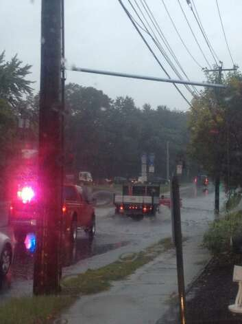 Cars had to avoid flooding at the intersection of Kings Highway and Chambers Street in Fairfield, Conn. during a heavy rain storm on Friday, Sept. 28, 2012. Photo: Contributed Photo