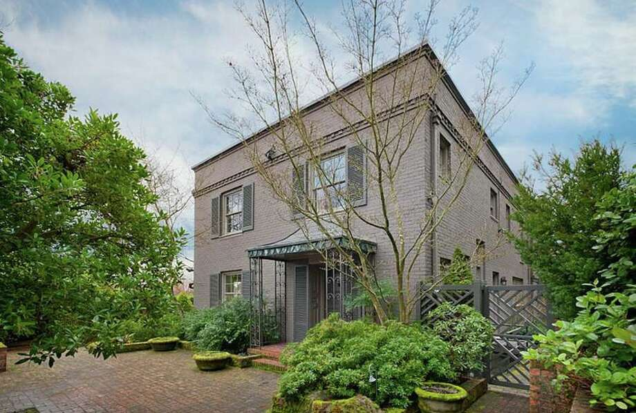 Washington Park includes some of Seattle's most-elegant homes. Here's a good example, 3821 E. Prospect St. The 4,010-square-foot house, built in 1936, has four bedrooms, 4.25 bathrooms, built-in shelves, French doors leading from the library and living room to a brick patio, and views of Lake Washington and the Cascade mountains on a 0.26-acre corner lot. It's listed for $3.395 million. Photo: Courtesy Anne Willoughby Nelson/Madison House,  Ltd