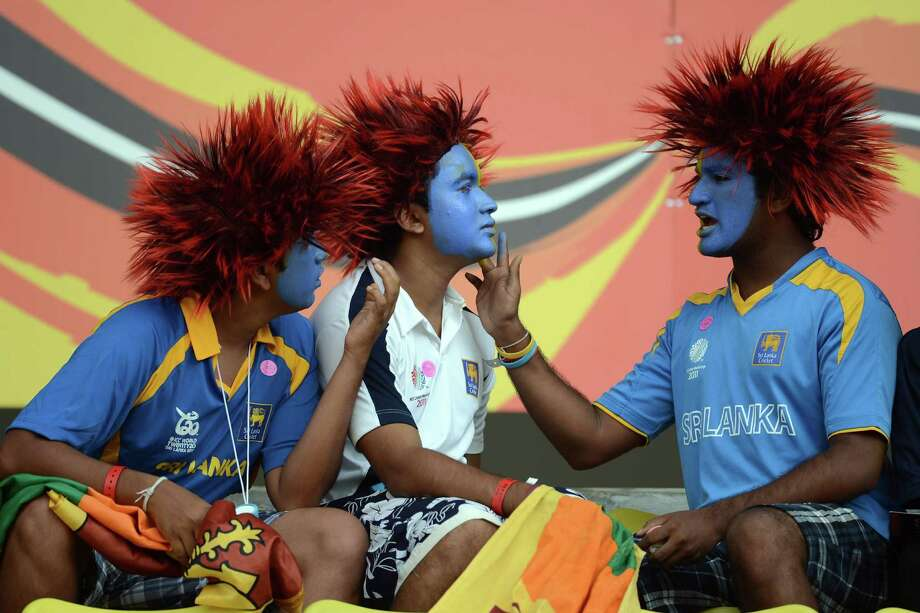 Sri Lankan cricket fans have their faces painted during the ICC Twenty20 Cricket World Cup's Super Eight match between Sri Lanka and New Zealand at the Pallekele International Cricket Stadium in Pallekele on Sept. 27, 2012. AFP PHOTO/ Prakash SINGH Photo: PRAKASH SINGH, Getty / 2012 AFP
