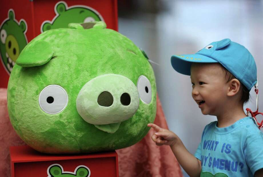 "A child touches a Bad Piggies stuffed toy from the Angry Birds game during a press conference in Taipei on Sept. 27, 2012.  ""Angry Birds"" maker Rovio is to launch a new title allowing users to play as the ""Bad Piggies"" from the smash-hit game, and take revenge on the birds who attacked them with slingshots.  AFP PHOTO / Sam Yeh Photo: Getty"