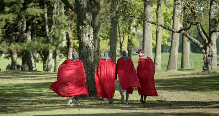 Fans dressed as crusaders walk along the seventh hole during the final preview day of the 39th Ryder Cup at the Medinah Country Club Sept. 27, 2012, in Medinah, Ill.  AFP PHOTO/Brendan SMIALOWSKI Photo: BRENDAN SMIALOWSKI, Getty / 2012 AFP