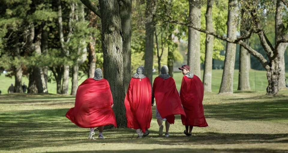 Fans dressed as crusaders walk along the seventh hole during the final preview day of the 39th Ryder