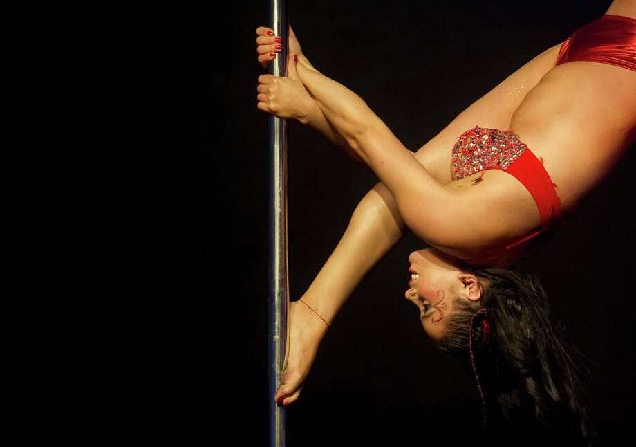Colombian Carolina Roldan competes in the Miss Pole Dance Colombia 2012 competition in Medellin, Colombia on Sept. 27, 2012. AFP PHOTO/Raul ARBOLEDA Photo: Getty