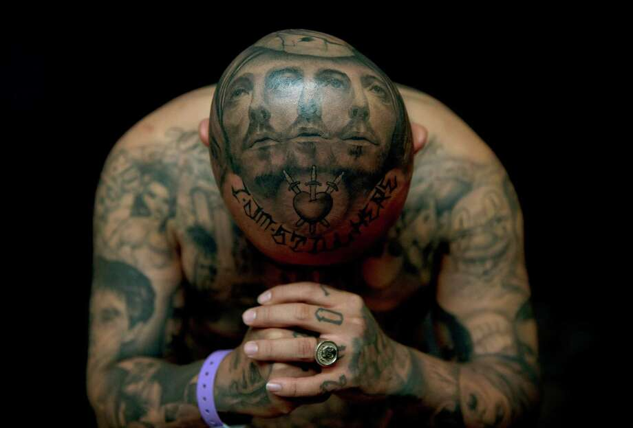 """Oldies"" poses for a photograph to display his tattoos by artist Josh Lin during the Eighth International London Tattoo convention at Tobacco Dock east London on Sept. 28, 2012.  World famous tattoo artists gathered in London for the annual event. AFP PHOTO / ADRIAN DENNIS Photo: ADRIAN DENNIS, Getty / 2012 AFP"