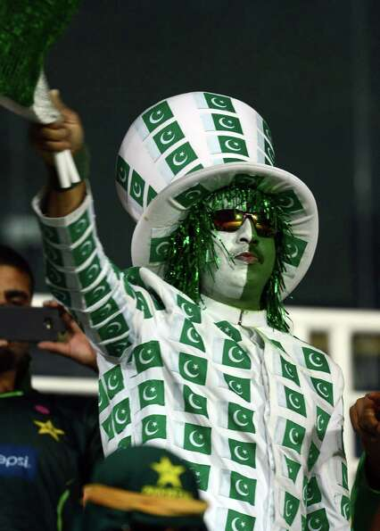 A Pakistan cricket fan cheers during the ICC Twenty20 Cricket World Cup match between Pakistan and B