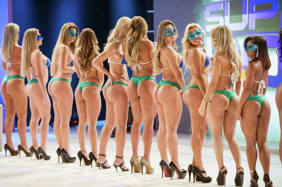 "Competitors of ""Miss Bumbum Brasil 2012"", the contest for the cutest bottom, wait to record a TV program in Osasco, a surburb of Sao Paulo, Brazil on Sept. 24, 2012. Brazil's 27 states and Federal District representatives compete for the cutest bottom. Competitors will be eliminated into 15 by internet voting on their website and the winner will be chosen at the grand final in Sao Paulo in November. AFP PHOTO/Yasuyoshi CHIBA Photo: AFP, Getty / 2012 AFP"