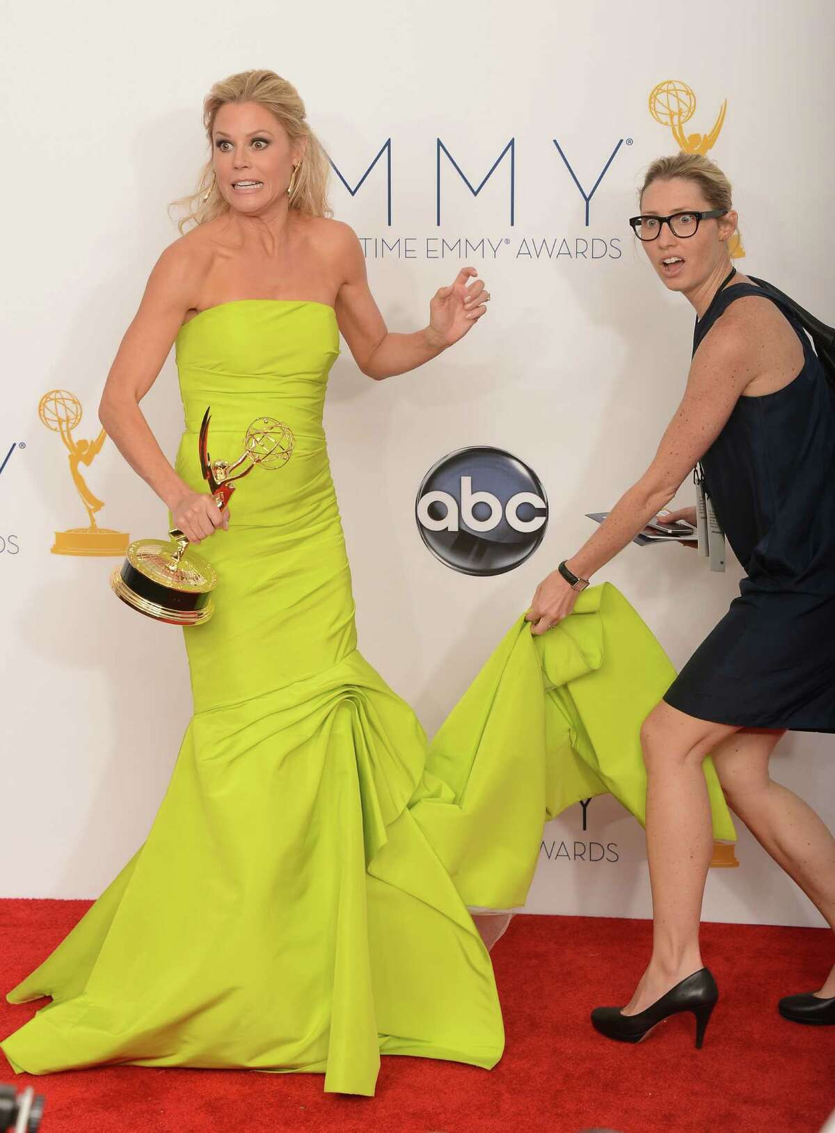 Julie Bowen arrives in the press room at the 64th annual Prime Time Emmy Awards at the Nokia Theatre at LA Live in Los Angeles on Sept. 23, 2012. AFP PHOTO / JOE KLAMAR