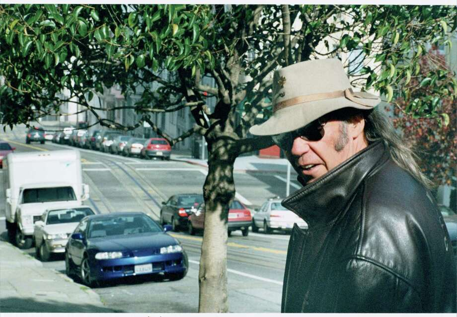 Neil Young wants everyone to know he's not grumpy; he just looks that way in all of his pictures. Maybe he could just stop looking grumpy in pictures, then.  / email