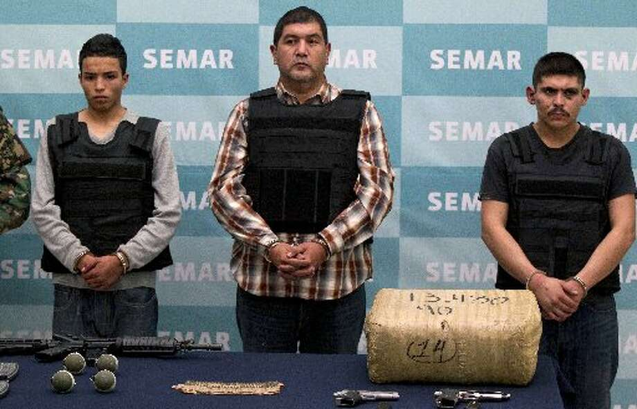 "In this file photo, Zetas cartel leader Ivan Velazquez Caballero, known as ""El Taliban, "" center, is shown during a media presentation in Mexico City.Keep going for a look at what you need to know about the Zetas cartel."
