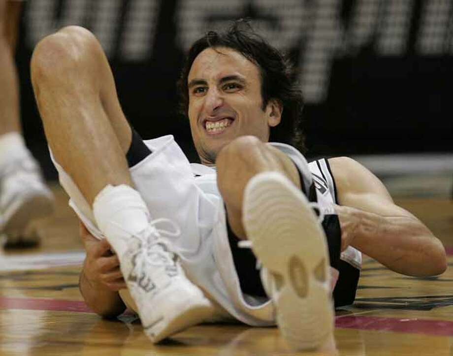 The Spurs' Manu Ginobili looks up after falling during the first quarter of Game 4 of the Western Conference Finals in San Antonio on May 30, 2005. Photo: DAVID J. PHILLIP, AP / AP