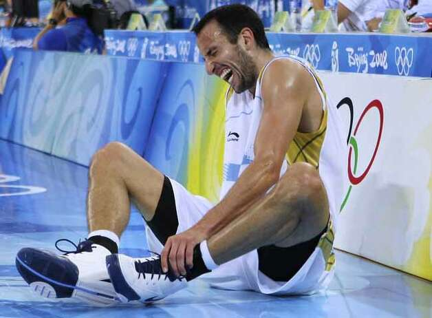 Argentina's Manu Ginobili reacts after injuring his ankle during a semifinal game against Team USA at the 2008 Beijing Olympics on Aug. 22, 2008, in Beijing, China. The USA won 101-81. Photo: EDWARD A. ORNELAS, SAN ANTONIO EXPRESS-NEWS / eornelas@express-news.net