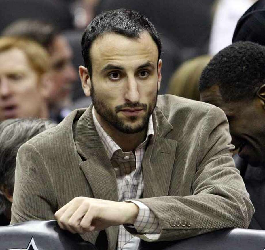 The Spurs' Manu Ginobili sits on the bench during the first half against the Portland Trail Blazers on March 28, 2011, at the AT&T Center. Photo: EDWARD A. ORNELAS, SAN ANTONIO EXPRESS-NEWS / SAN ANTONIO EXPRESS-NEWS (NFS)