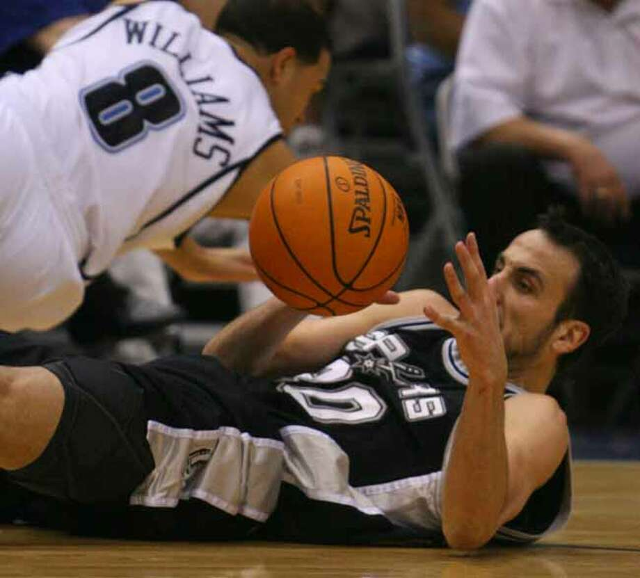 Spurs guard Manu Ginobili waits to recover the loose ball as Utah Jazz guard Deron Williams falls to the court during first half action in Game 4 of the Western Conference Finals in Salt Lake City on May 28, 2007. Photo: EDWARD A ORNELAS, SAN ANTONIO EXPRESS-NEWS / SAN ANTONIO EXPRESS-NEWS