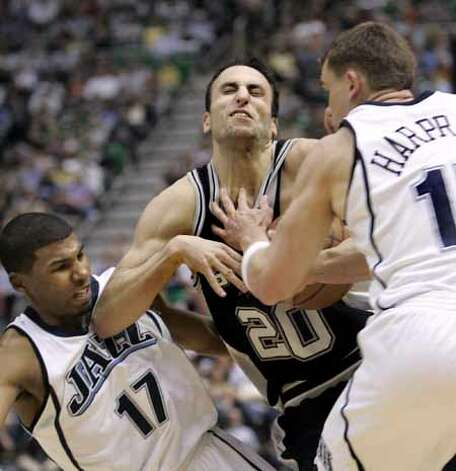 The Spurs' Manu Ginobili is fouled by Utah Jazz guard Ronnie Price as he tries to slip between Price and Jazz forward Matt Harpring (right)  on April 4, 2008, in Salt Lake City. Photo: Douglas C. Pizac, AP / AP