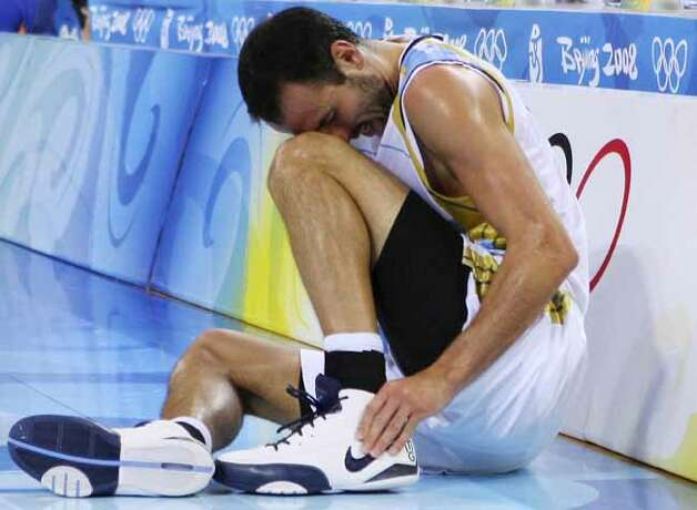 Argentina's Manu Ginobili reacts after injuring his ankle during the first half of a semifinal game against Team USA at the 2008 Beijing Olympics on Aug. 22, 2008 in Beijing, China. The USA won 101-81. Photo: EDWARD A. ORNELAS, SAN ANTONIO EXPRESS-NEWS / eornelas@express-news.net