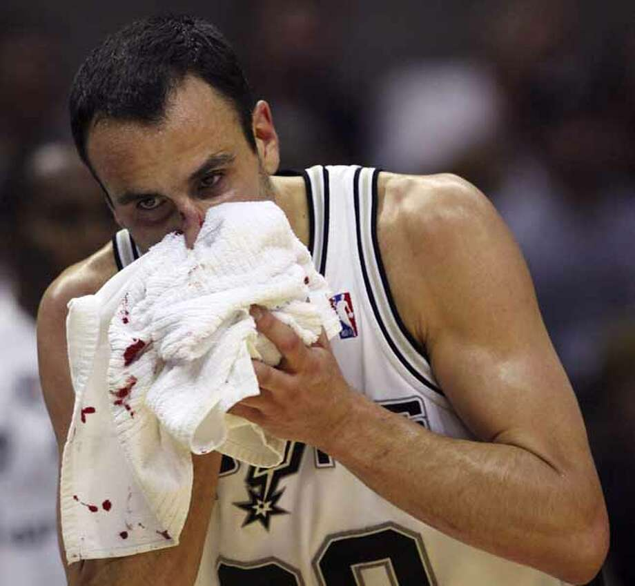 The Spurs' Manu Ginobili leaves the court after being hit in the nose during the third quarter of Game 3 of the first round of the NBA playoffs against the Dallas Mavericks on April 23, 2010, at the AT&T Center. Photo: EDWARD A. ORNELAS, SAN ANTONIO EXPRESS-NEWS / © 2010 SAN ANTONIO EXPRESS-NEWS