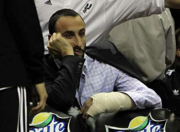 The Spurs' Manu Ginobili recovers from hand surgery while attending a game against the Denver Nuggets at the AT&T Center on Jan. 7, 2012. Photo: KIN MAN HUI, SAN ANTONIO EXPRESS-NEWS / SAN ANTONIO EXPRESS-NEWS
