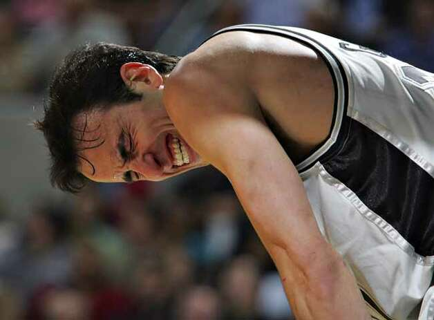 The Spurs' Manu Ginobili grimaces after taking a hard foul from the Phoenix Suns' Raja Bell in the second half  on Nov. 8, 2006, at the AT&T Center. The Spurs won 111-106 in overtime. Photo: BAHRAM MARK SOBHANI, SAN ANTONIO EXPRESS NEWS / SAN ANTONIO EXPRESS NEWS