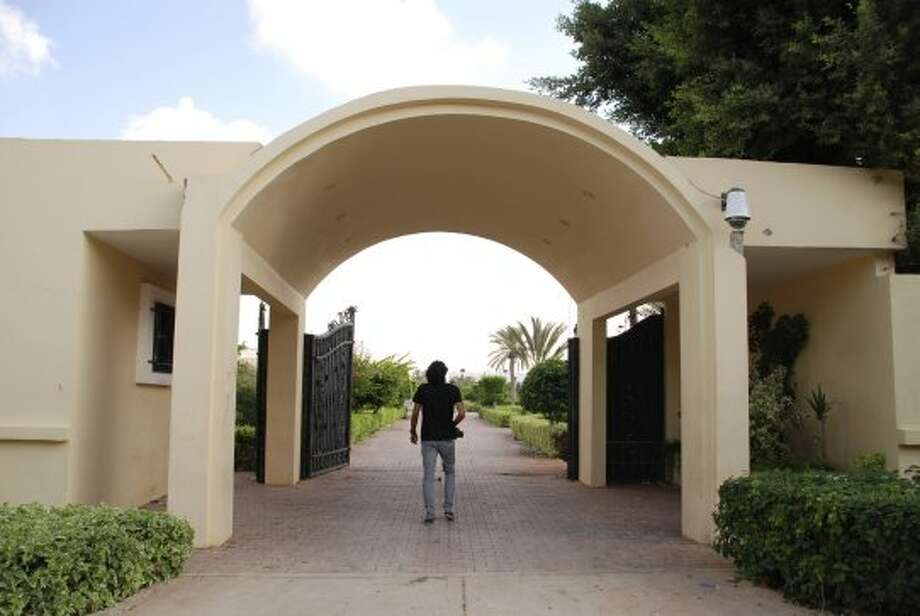 A man walks on the grounds of the U.S. consulate in Benghazi, Libya, after an attack that killed four Americans, including Ambassador Chris Stevens, Wednesday, Sept. 12, 2012. The American ambassador to Libya and three other Americans were killed when a mob of protesters and gunmen overwhelmed the U.S. Consulate in Benghazi, setting fire to it in outrage over a film that ridicules Islam's Prophet Muhammad. Ambassador Chris Stevens, 52, died as he and a group of embassy employees went to the consulate to try to evacuate staff as a crowd of hundreds attacked the consulate Tuesday evening, many of them firing machine-guns and rocket-propelled grenades. (Ibrahim Alaguri / Associated Press)