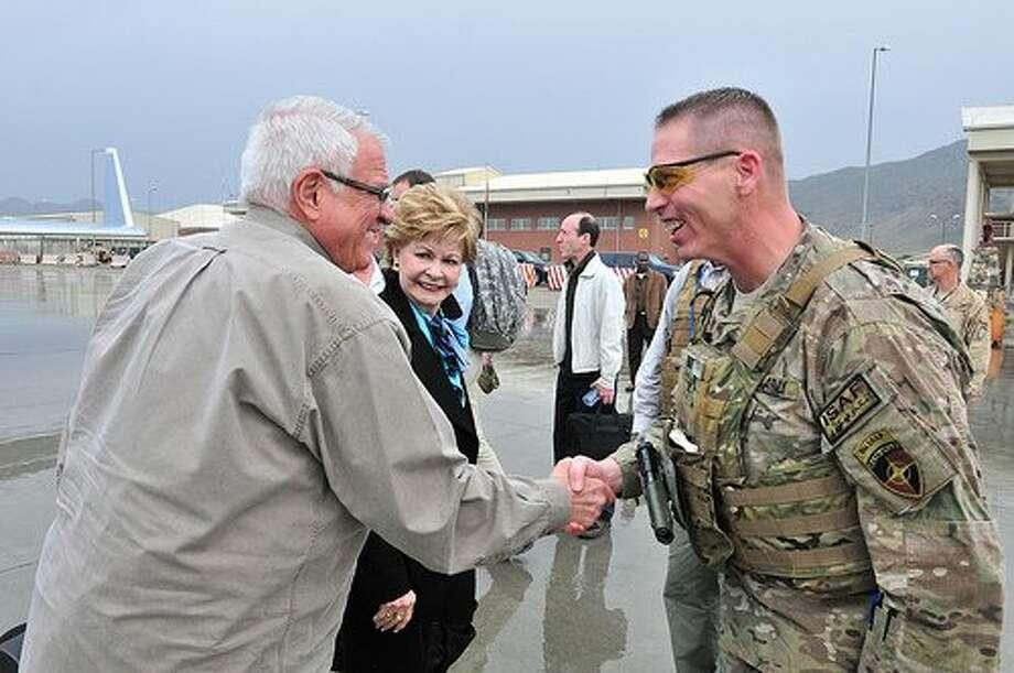 Rep. John Carter, R-Round Rock, shakes the hand of U.S. serviceman. (Facebook of John Carter)