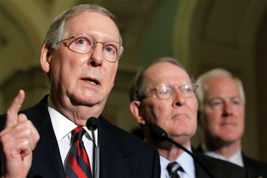 Senate Minority Leader Mitch McConnell of Ky., left, accompanied by Sen. Lamar Alexander, R-Tenn., center, and Sen. John Cornyn, R-Texas, gestures during a news conference on Capitol Hill in Washington, Tuesday, Nov. 16, 2010. (AP Photo/Alex Brandon) (AP)
