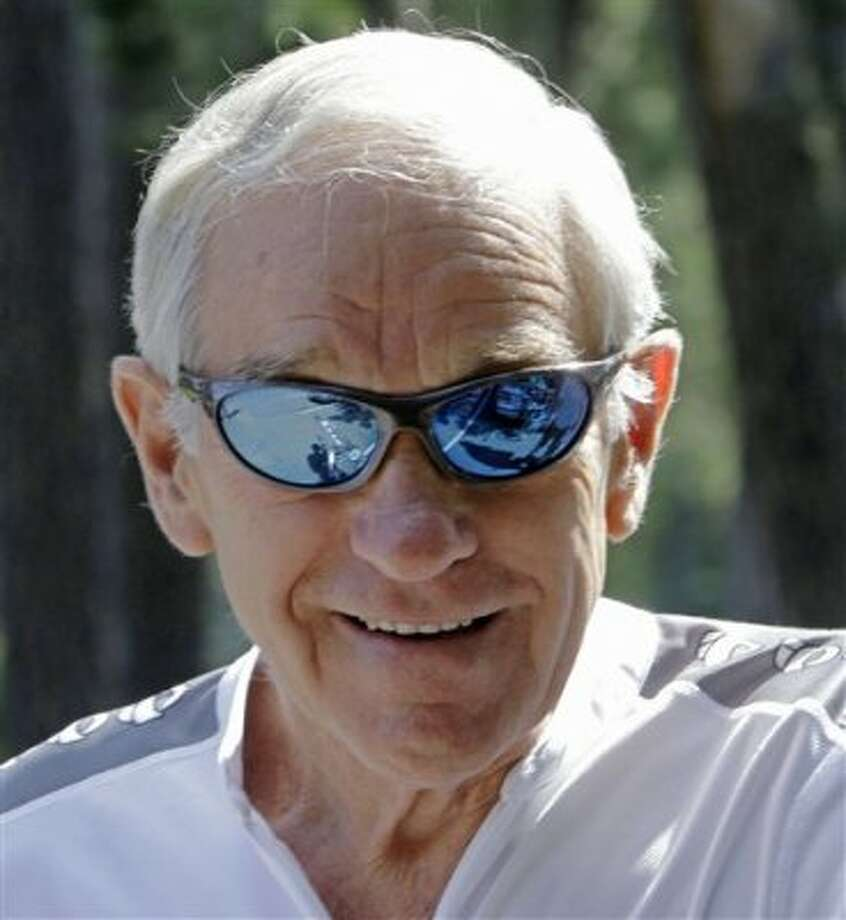 Republican presidential candidate, Rep. Ron Paul, Texas takes a break from the campaign as he gets ready to go for a bike ride, Friday, Sept. 2, 2011, in Manchester, N.H. (AP Photo/Jim Cole) (AP)