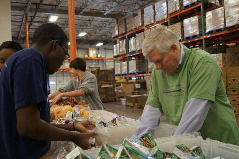 Rep. Pete Sessions helped sort and pack Senior Care Packages at the North Texas Food Bank's Cockrell Hill warehouse with his Dallas staff and local volunteers on March 15, 2012. (Facebook of Pete Sessions)