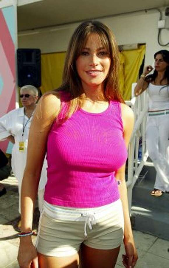"Before Sofia Vergara, 40, was on ""Modern Family,"" she was a model and TV personality on Spanish language shows. She's pictured in 2003 during a taping for ""MTV Spring Break"" in Miami.  (Getty Images)"