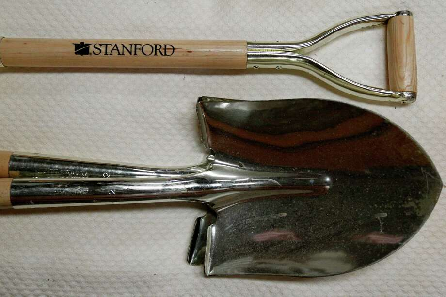 Shovels stamped with company logo used at groundbreakings, unknown value, are part of Stanford Financial Group's assets which will be auctioned in attempts to fundraise money to repay victims of imprisoned R. Allen's Stanford on Thursday, Sept. 27, 2012, in Houston. Photo: Mayra Beltran, Houston Chronicle / © 2012 Houston Chronicle