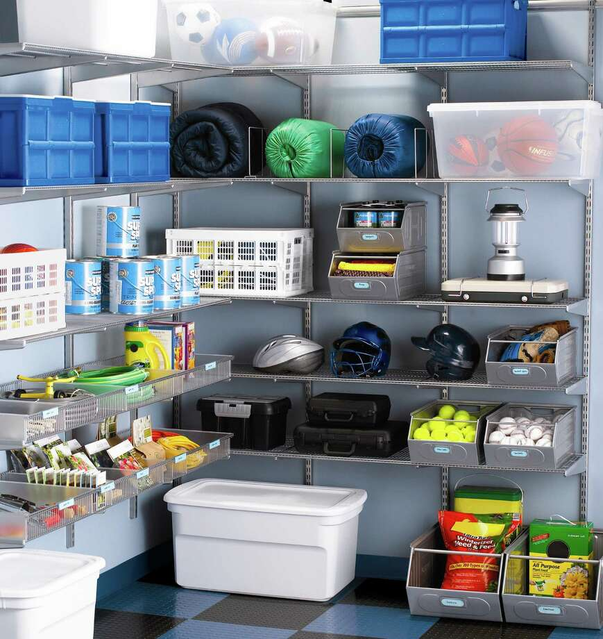 Shelving and storage containers help  keep a garage tidy and make items easier to find. Photo: The Container Store / The Container Store
