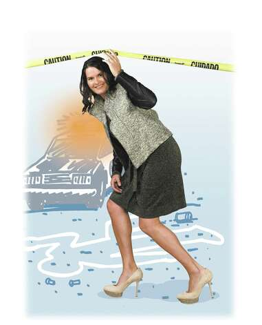 "Trish McGarrity poses as Angie Harmon from ""Law & Order."""
