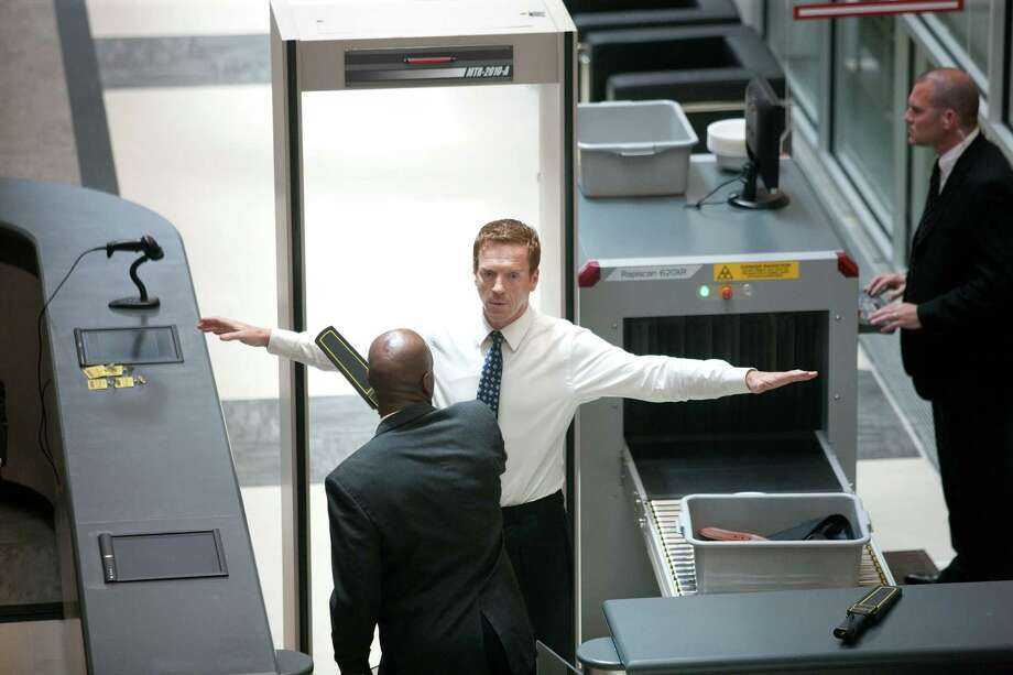 """Nicholas Brody (Damian Lewis, center) goes through security in the Season 2 premiere of the Emmy-winning Showtime drama """"Homeland."""" Photo: Kent Smith / Copyright:  Showtime 2012"""