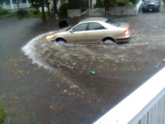 A car in Bridgeport was almost completely under water Friday, Sept. 28, 2012 after southwestern Connecticut was hit with a round of heavy rain. Photo: Contributed Photo