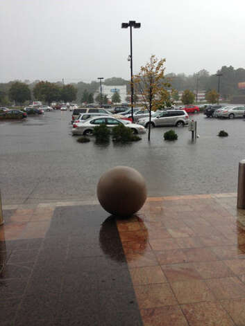 The parking lot of the Connecticut Post Mall in Milford, Conn. was flooded Friday, Sept. 28, 2012 after heavy rain hit the area. Photo: WTNH Report-It