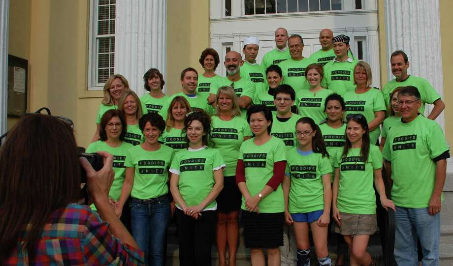 Representatives of Westport food establishments that will be participating in the Downtown Westport Foodie Fest from Oct. 26-28 pose for a portrait Thursday on the steps of Town Hall to promote the new event. Photo: Jarret Liotta / Westport News contributed