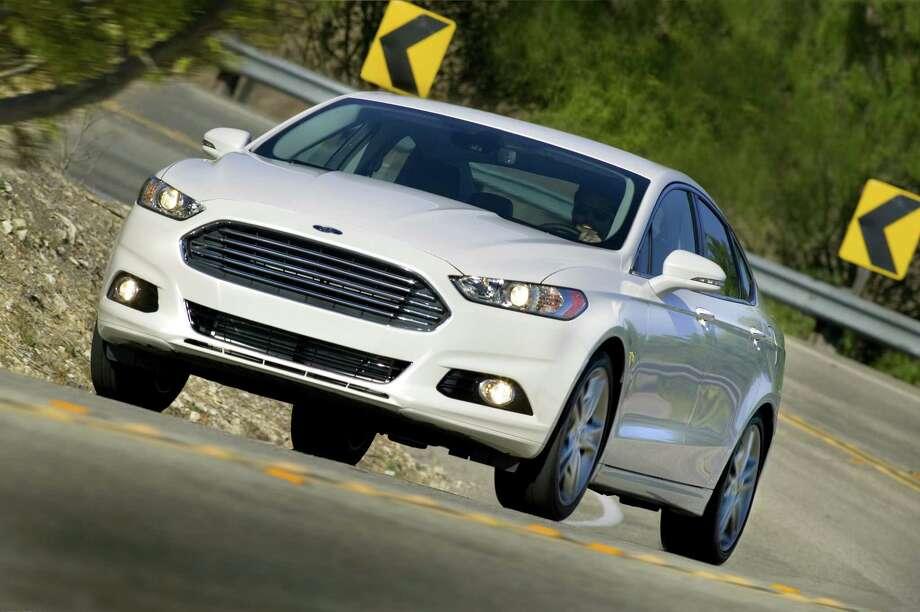 Ford?s 2013 Fusion sedan has a sleeker, more-aerodynamic body. / © 2012 Ford Motor Company